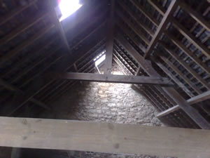 Images of slate roof that was suffering from slate slippage due to mechanical fixings clips and nails corroding.